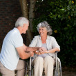 Mature couple in the garden - Stock Photo
