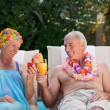 Happy senior couple drinking cocktails and toasting each other — Stock Photo #10848412