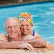 Stock Photo: Happy mature couple in swimming pool
