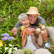 Man hugging his woman in the garden — Stock Photo #10848463