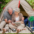 Happy couple camping in the garden — Stock Photo