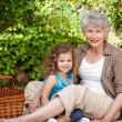Grandmother with her granddaughter in the garden — Stock Photo