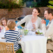 Family eating in the garden — Stock Photo #10848559