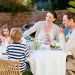 Royalty-Free Stock Photo: Family eating in the garden
