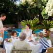 Family eating in the garden — Stock Photo #10848561