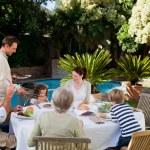 Family eating in the garden — Stock Photo