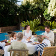 Family eating in the garden — Stock Photo #10848564