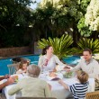 Family eating in the garden — Stock Photo #10848566