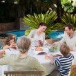 Family eating in the garden — Stock Photo