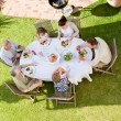 Family eating in the garden — Stock Photo #10848578