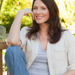 Portrait of a lovely woman in the garden — Stock Photo