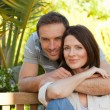 Joyful couple hugging in the garden — Stock Photo #10848607