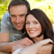 Joyful couple hugging in the garden — Stock Photo #10848609