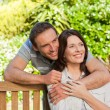 Joyful couple hugging in the garden — Stock Photo