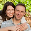 Glad couple hugging in the garden — Stock Photo #10848623