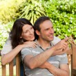 Stock Photo: Glad couple hugging in garden