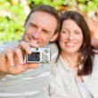 Royalty-Free Stock Photo: Lovers taking a photo of themselves in the garden