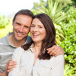 Beautiful woman with her husband in the garden — Stock Photo