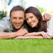 Stock Photo: Couple lying down in garden