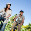 Joyful couple with their bikes — Stock Photo