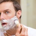 Man shaving in the bathroom — Stock Photo