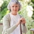 Retired woman with her walking stick — Stock Photo #10848842