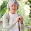 Retired womwith her walking stick — Stock Photo #10848842