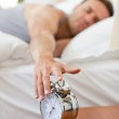 Man waking up in his bed — Stock Photo #10849081