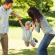 Stock Photo: Joyful family in the park