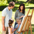 Stock Photo: Family painting together in the park