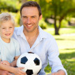 Father with his son after a football game — Stock Photo #10849236