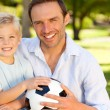 Father with his son after a football game — Stock Photo