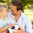 Father with his son after a football game — Stock Photo #10849250