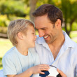 Father with his son after a football game — Stock Photo #10849252