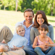 Family sitting in the park — Stock Photo
