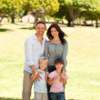 Portrait of a family in the park — Stock Photo
