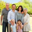 Family standing in the park — Stock Photo
