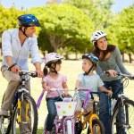 Family with their bikes — Stock Photo
