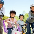 Family with their bikes — Stock Photo #10849392