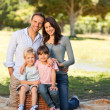 Smiling family picnicking in the park — Stock Photo #10849451