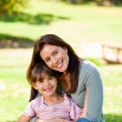 Happy mother with her daughter in the park — Stock Photo
