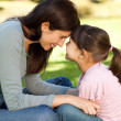 Happy mother with her daughter in the park — Stock Photo #10849538
