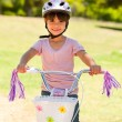 Stock Photo: Girl with her bike