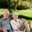 Stock Photo: Senior couple sitting on a bench