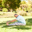 Mature man doing his streches in the park — Stock Photo