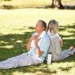 Couple after their streches in the park — Stock Photo