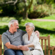 Senior couple sitting on a bench — Stock Photo
