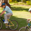 Retired couple mountain biking outside - Foto Stock