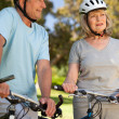 Stock Photo: Elderly couple with their bikes