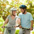 Couple with their bikes in the wood - Foto Stock